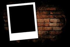 Photo frames on brick wall Royalty Free Stock Images