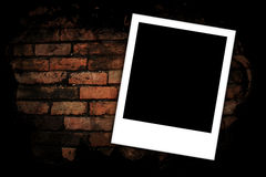 Photo frames on brick wall Royalty Free Stock Image