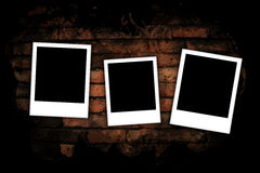 Photo frames on brick wall Stock Images