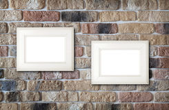Photo frames on brick wall Royalty Free Stock Photos