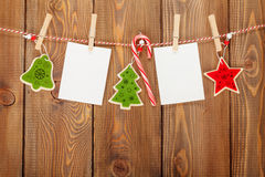 Photo frames and christmas decor on rope Stock Photography