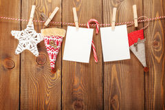 Photo frames and christmas decor on rope Royalty Free Stock Images