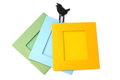 Photo frames with clips isolated on a white birds. Stock Photo