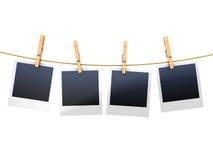 Photo frames on clothesline Stock Photography