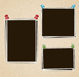 Photo frames composition with pushpins on retro background Stock Photography