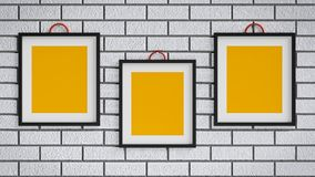 Photo frames 3d rendering. Three Photo frames having copy space in a wall 3d rendering Royalty Free Stock Images