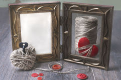 Photo frames and handmaded valentines day toy hearts over wooden background. with copy space Royalty Free Stock Image