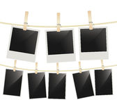 Photo frames hanging on clothesline with clothespins on white Royalty Free Stock Photography