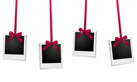 Photo frames hanging on red ribbon Royalty Free Stock Photo