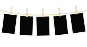 Photo frames hanging on a rope with clothespins Stock Image