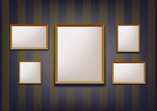 Photo frames hanging on the wall Royalty Free Stock Photos