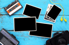 photo frames next to old tape recorder and camera Royalty Free Stock Photos