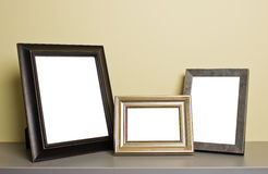 Photo frames on old table Royalty Free Stock Photo