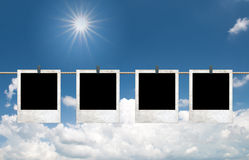 Photo frames over Blue sky with clouds and sun Stock Image
