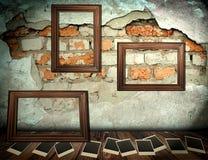 Photo frames over grunge room Stock Photos