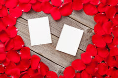 Photo frames over wood and red rose petals Royalty Free Stock Photo