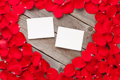 Photo frames over wood and red rose petals Stock Photos