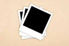 Photo frames on paper background Stock Image