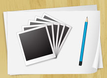 Photo frames and papers Royalty Free Stock Image