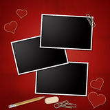 Photo frames on red background. Photo frames with pencil, eraser, clip, notepad, heart Royalty Free Stock Photography