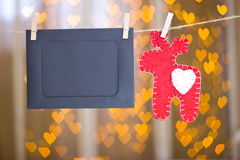 Photo frames and red deer made of felt. Stock Image
