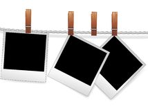 Photo frames on rope. Photo snapshot frames on rope for scrap. Polaroid blank for picture of family album. Element for design Royalty Free Stock Photo