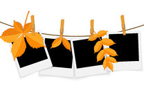 Photo frames on rope with clothespins and autumn leaves Stock Photography