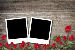 Photo frames rose on wood background Royalty Free Stock Images