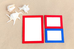 Photo frames on sand Stock Photos