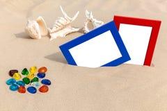 Photo frames on sand Royalty Free Stock Photo