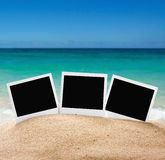 Photo frames on the sea sand on the beach Stock Photography