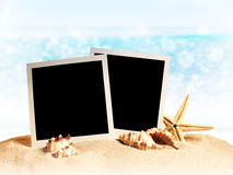 Photo frames on the sea sand Royalty Free Stock Photo