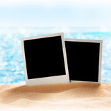 Photo frames on the sea sand Royalty Free Stock Photography