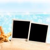 Photo frames on the sea sand Stock Image