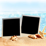 Photo frames on the sea sand Stock Images