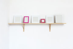 Photo frames on a shelf Royalty Free Stock Photography