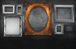Photo frames on vintage wall Royalty Free Stock Image