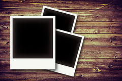 Photo frames on vintage wooden board Royalty Free Stock Images