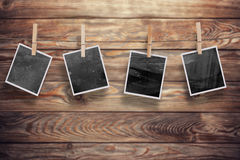 Photo frames on wood Stock Images