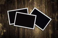 Photo frames on wood background Stock Photo