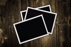 Photo frames on wood background Stock Image