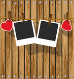 Photo frames on wood background. Royalty Free Stock Photo