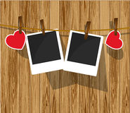 Photo frames on wood background. Stock Photography