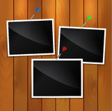 Photo. Frames on wooden background Royalty Free Stock Image