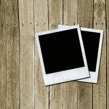 Photo frames on wooden texture Royalty Free Stock Images