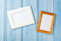 Photo frames on wooden wall Stock Photography