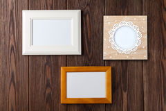 Photo frames on wooden wall Royalty Free Stock Photography