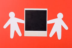 Photo of a framework. Two silhouettes of the person represent a photo of a framework on an orange background Royalty Free Stock Images
