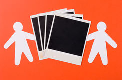 Photo of a framework. Two silhouettes of the person represent a photo of a framework on an orange background Royalty Free Stock Photo