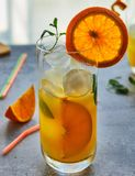 Photo of fresh orange juice in the glass jar. Summer healthy organic drink concept royalty free stock photos